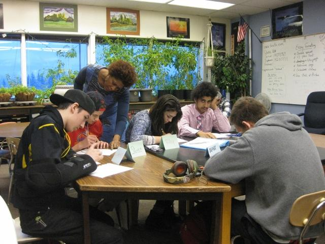Dasha helps students create their poems.