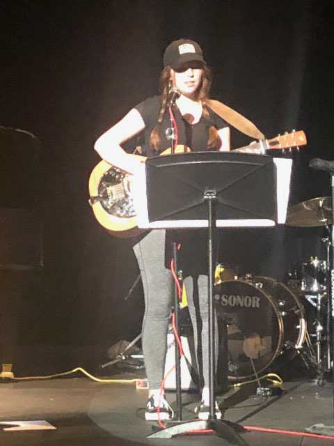Rowan performs and plays guitar.