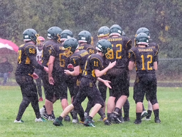 Football team in their final game against Kenai